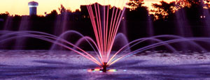 Floating fountain lighted at night