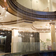 Detail of water curtain in a reception hotel staff