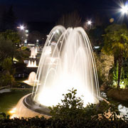 Architectural fountain illuminated at night and made up by lance jet III