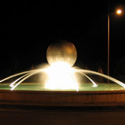 Architectural fountain illuminated at night