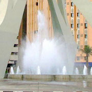 Fountain with spraying clouds nozzle in the middle